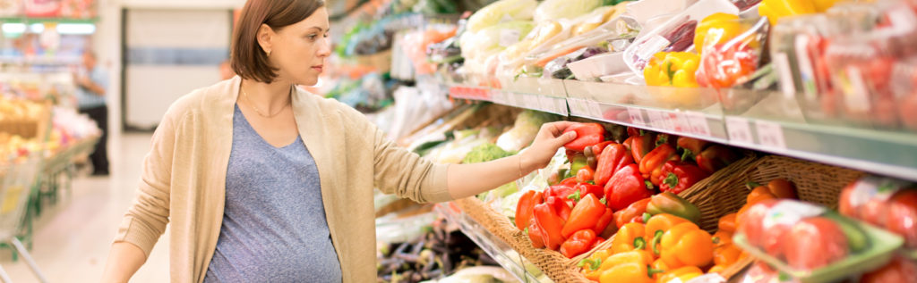 Pregnant Woman Shopping for Veggies
